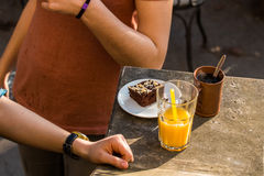 Afternoon break. With drink and dessert Royalty Free Stock Images