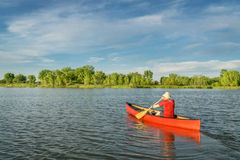 Afternoon canoe paddling on lake Stock Photo