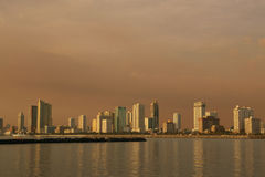 Afternoon-cityscape. Manila Philippines, city skyline view from manila bay Stock Photos