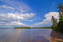 Afternoon clouds on a wilderness lake. Dunphy's Pond in Terra Nova National Park Royalty Free Stock Photos