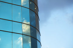Cloudy Office Building. Afternoon cloudy sky reflecting off an office building's curtain wall Royalty Free Stock Photography
