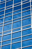 Afternoon cloudy sky reflecting off an office building's curtain Royalty Free Stock Images