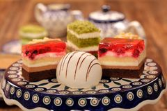 Afternoon coffee and cake with jelly and fruits on wooden background stock photos