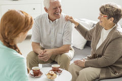 Afternoon in common room. Two older patients of nursing home spending afternoon in common room Royalty Free Stock Image