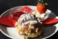 Afternoon cream tea / english scone, jam, clotted cream. A traditional English afternoon high tea famous in the UK in Cornwall, Devon and the West Country royalty free stock photography