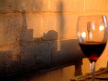 Afternoon Delight. Wine glass with wall shadows Stock Photography