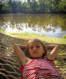 Afternoon Delight. A Young Girl Lying in a Hammock by the lake Stock Image