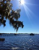 AFTERNOON ON DOCTOR'S LAKE, FLEMMING ISLAND FLORIDA. Amazing blue sky and water as the sun glistens down on the lake stock photos