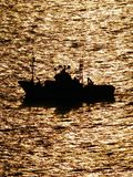 Afternoon gold boat Royalty Free Stock Photo