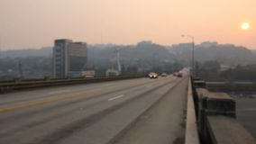 Afternoon Haze and air pollution on Ross Island Bridge in Portland Oregon due to forest wildfires at Sunset 1080p stock video