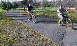 Afternoon on the Local Greenway. Roanoke, VA - December 15TH: Two bikers (blurry for effect) and two elderly walkers enjoying an afternoon on the Roanoke Stock Photos