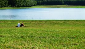 An afternoon in the park. Couple sitting on the grass Stock Photography