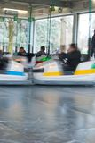 Children having fun on bumper cars. Afternoon at the playground games with the family Stock Photography