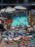 Afternoon at the Pool. Relaxing by the pool in the midday sun on deck Royalty Free Stock Photo