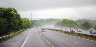 Afternoon shower on a highway Royalty Free Stock Images