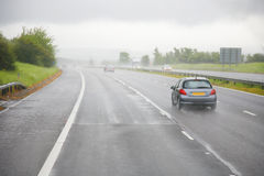 Afternoon shower on a highway stock photography