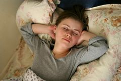 Afternoon sleep. Woman takeing a nap Stock Image