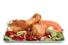 Afternoon snack, salad with drumsticks. Afternoon snack, roasted chicken drumsticks, tomato and salad. Nutrition, food concept Stock Images