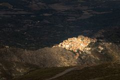 Afternoon sun lighting up village of Speloncato in Corsica Stock Photos