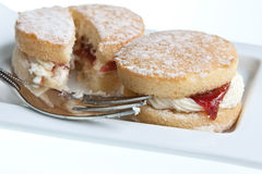 Afternoon Tea. Mini Victoria sponge cakes with buttercream & strawberry jam with a dusting of icing sugar Stock Photo