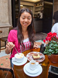 Afternoon Tea. The chinese gril enjoy her afternoon tea,in milan Royalty Free Stock Images