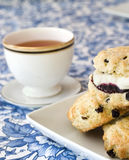 Afternoon tea. Scones with jam and cream, and a cup of tea Stock Image