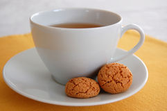 Afternoon Tea. A cup of tea with cookies on the plate Stock Photo