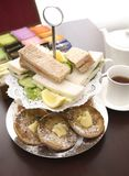 Afternoon tea. An arrangement of sandwiches and scones for afternoon tea Royalty Free Stock Photography
