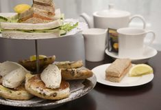 Afternoon tea. An arrangement of sandwiches and scones for afternoon tea Royalty Free Stock Image