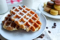 Afternoon tea. Belgain waffle and macarons with a cup of coffee Royalty Free Stock Images