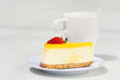 Afternoon tea break. Slice of strawberry cheese cake with a cup of coffee Stock Photography