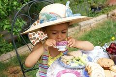 Afternoon tea, little girl Stock Photos