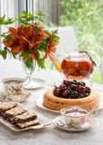 Afternoon tea in the garden, retro style. Royalty Free Stock Photography