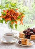 Afternoon tea in the garden, retro style. Royalty Free Stock Image