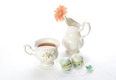 Afternoon tea. With orange flower and macaroons Royalty Free Stock Image