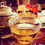 Afternoon tea. Relaxing time with camomile tea and strawberry Royalty Free Stock Images