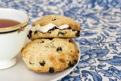 Afternoon tea with scones. Scones with jam and cream, and a cup of tea Stock Photography