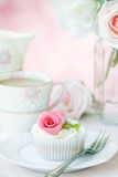 Afternoon tea. Served with a rose cupcake Stock Photography