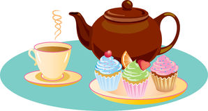 Afternoon Tea. With sugar iced cupcakes and a hot refreshing cup of tea Royalty Free Stock Images