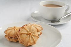 Tea and Viennese whirls Stock Photography