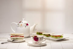 Afternoon tea table. tea set with sandwiches Stock Image