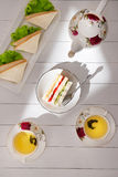 Afternoon tea table. tea set with sandwiches Stock Photo