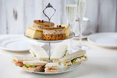 Afternoon tea. Traditional english afternoon tea with cakes and sandwiches Royalty Free Stock Photo