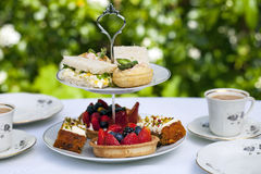 Afternoon tea. Traditional English afternoon tea with cakes and sandwiches Royalty Free Stock Photos