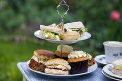 Afternoon tea. Traditional English afternoon tea with cakes and sandwiches Royalty Free Stock Image
