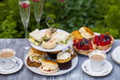 Afternoon tea. Traditional English afternoon tea with cakes and sandwiches Royalty Free Stock Photography
