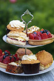 Afternoon tea. Traditional English afternoon tea with cakes and sandwiches Stock Photos