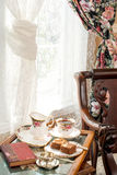 Afternoon tea in a tray by the window. Royalty Free Stock Image