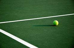 Afternoon Tennis. Single tennis ball on court Stock Photography