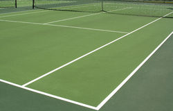 Afternoon tennis. View of an empty tennis court with a shadow from a light Stock Photo